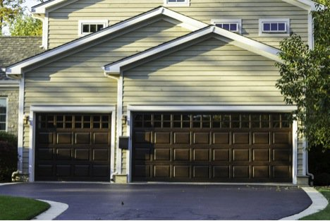 house with big brown garage doors