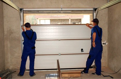 two men installing garage door